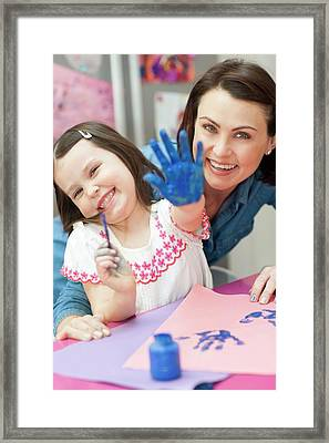 Young Girl Painting Framed Print