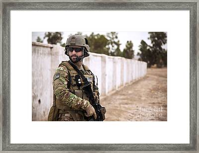 A Coalition Force Member Maintains Framed Print