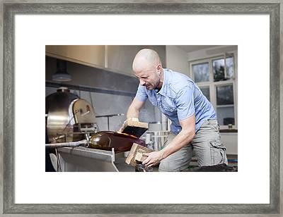 Glassblower At Work Framed Print