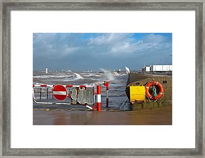 Huge Waves Crashing Onto Promenade Framed Print by Ken Biggs