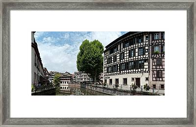 Reflection Of Buildings On Water Framed Print