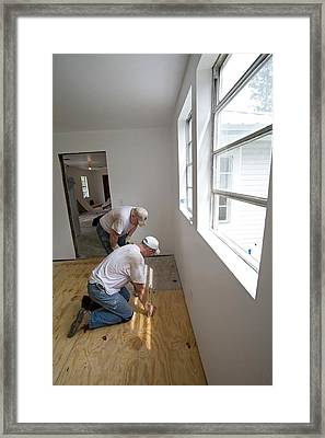 Repairing Hurricane Katrina Damage Framed Print