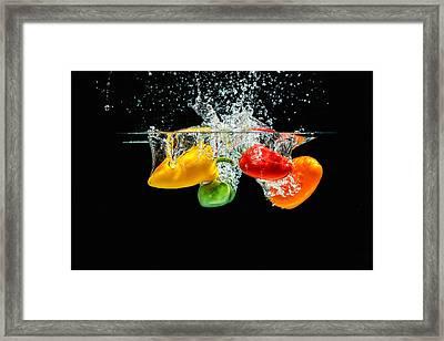 Splashing Paprika Framed Print