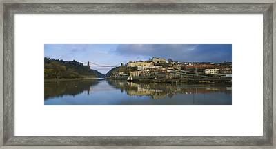 Suspension Bridge Across A River Framed Print by Panoramic Images