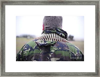 7.62mm Rounds Around The Shoulders Framed Print by Andrew Chittock