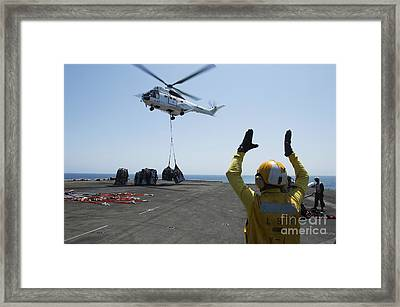 Aviation Boatswains Mate Directs An Framed Print