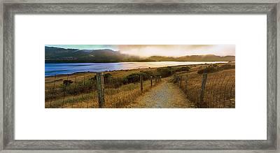 Dirt Road Passing Through A Landscape Framed Print