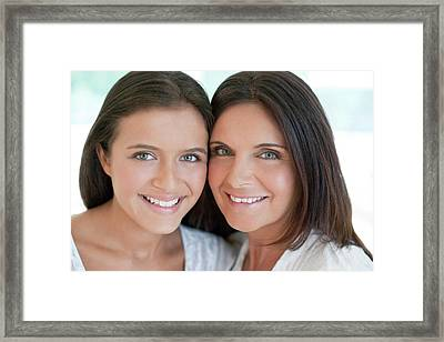 Mother And Teenage Daughter Framed Print by Ian Hooton/science Photo Library