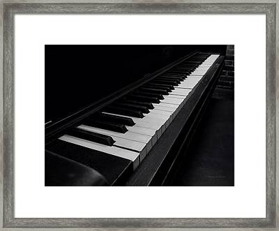 88 Keys Framed Print by Thomas Woolworth
