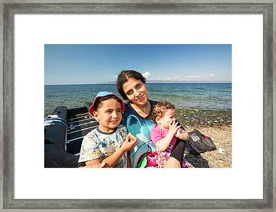 Syrian Refugees Arriving On Greek Island Framed Print by Ashley Cooper