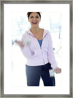 Woman Exercising Framed Print by Ian Hooton/science Photo Library