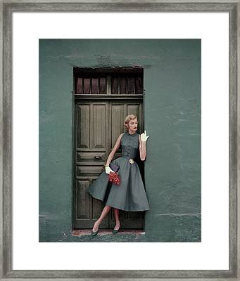 A 1950s Model Standing In A Doorway Framed Print by Leombruno-Bodi