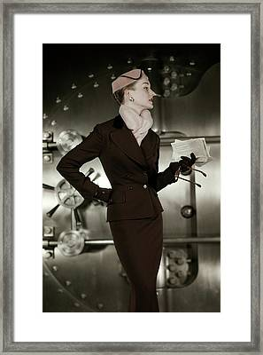 A 1950s Model Wearing A Tweed Suit Framed Print