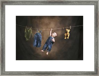 A Baby On The Clothesline Framed Print