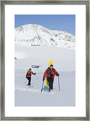 A Backcountry Skier And Snowboarder Get Framed Print by Dan Bailey