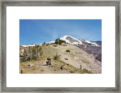 A Backpacker Ties His Shoe While Hiking Framed Print
