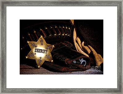 A Badge And A Weapon Framed Print by Olivier Le Queinec