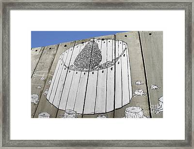 A Banksy Graffiti On The Separation Wall In Palestine Framed Print by Roberto Morgenthaler
