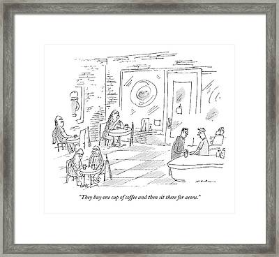 A Barista In A Coffee Shop Speaks To A Patron Framed Print
