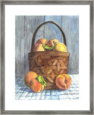 A Basket Of Peaches Framed Print by Carol Wisniewski