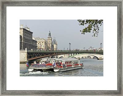 A Bateaux Cruises On The Seine River Framed Print by William Sutton