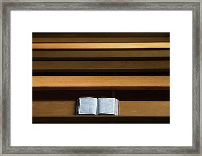 A Bible Open On A Wooden Bench Framed Print