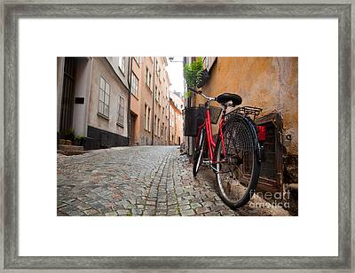 A Bike In The Old Town Of Stockholm Framed Print