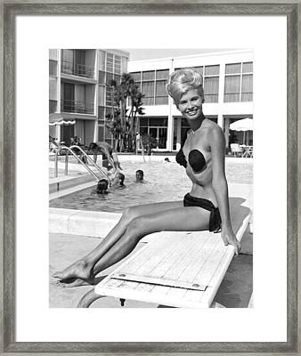 A Blonde Wearing A Tri Kini Framed Print by Underwood Archives