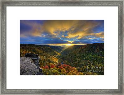 A Blue And Gold Sunset Framed Print by Dan Friend