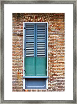 A Blue Door In New Orleans Framed Print by Christine Till