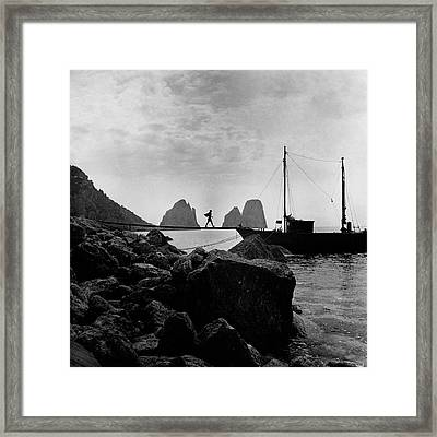 A Boat Docked At Capri Framed Print by Clifford Coffin