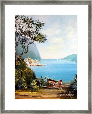 A Boat On The Beach Framed Print