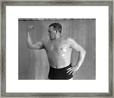 A Body Builder Poses Framed Print by Underwood Archives