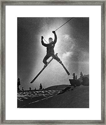 A Bold Leap By A Skier Framed Print by Underwood Archives