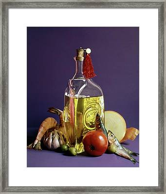 A Bottle Of Olive Oil Surrounded By A Variety Framed Print