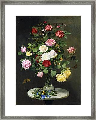 A Bouquet Of Roses In A Glass Vase By Wild Flowers On A Marble Table Framed Print