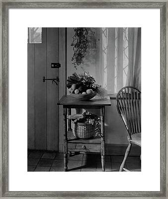 A Bowl Of Vegetables On A Table Framed Print