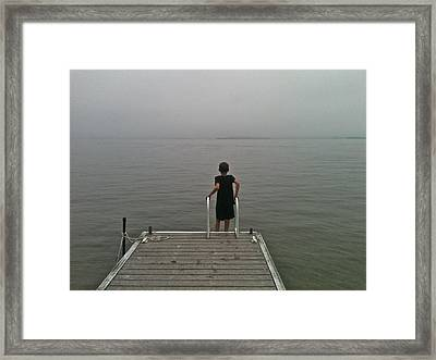 A Boy And A Lake Framed Print