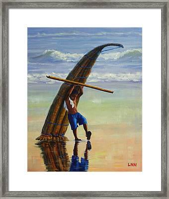 A Boy And His Caballito De Totora Framed Print