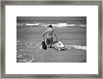 A Boy And His Dog Go Surfing Framed Print by Kristina Deane