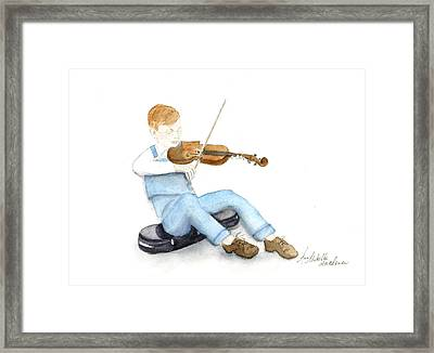 A Boy And His Violin Framed Print