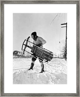 A Boy Carrying His Sled Framed Print by Underwood Archives