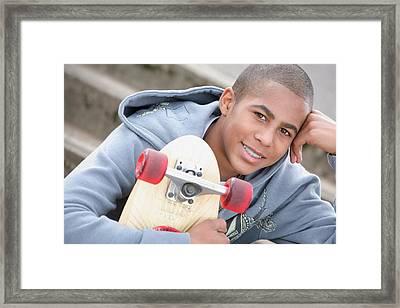 A Boy With A Skateboard Oregon, Usa Framed Print
