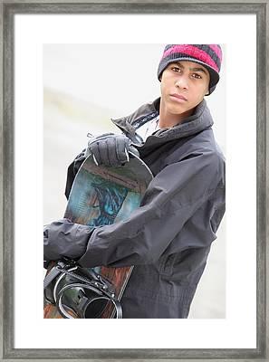 A Boy With A Snowboard Framed Print