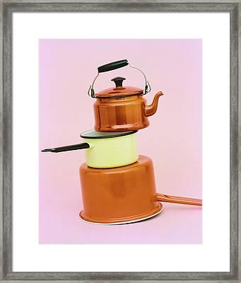 A Brass Teapot Stocked On Top Of Pots Framed Print