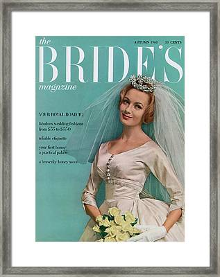 A Bride In A Ivory Wedding Dress Framed Print by Eveyln Hofer