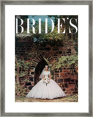 A Bride In Front Of Stone Gate Framed Print