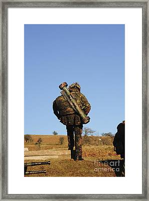 A British Soldier Carrying A Matador Framed Print by Andrew Chittock