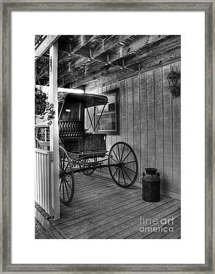 A Buggy On A Porch Bw Framed Print by Mel Steinhauer
