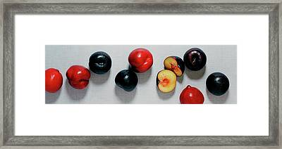 A Bunch Of Plums Framed Print by Romulo Yanes